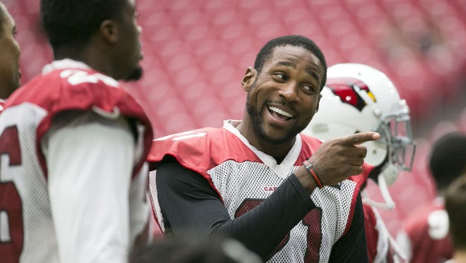 Cardinals cornerback Patrick Peterson jokes with a teammate during a Cardinals' training camp practice at University of Phoenix Stadium in Glendale on Wednesday, August 10, 2016.