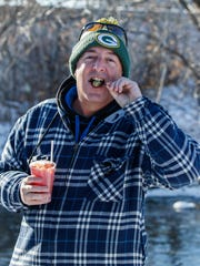 Terry Hogan of Waukesha enjoys a Bloody Mary cocktail prior to the 2018 Nemahbin Lakes Polar Plunge in the Village of Summit on  Jan. 1, 2018. Garnish your bloody Mary with a venison meat stick.