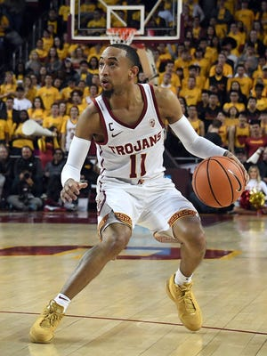 Guard Jordan McLaughlin (11) led Southern Cal past UNC Asheville in two overtimes Tuesday night in the first round of the NIT
