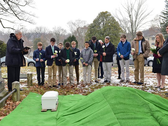 Students from Delbarton School in Morristown hold a funeral service Monday for a stillborn baby found abandoned at a Mine Hill recycling center in October.