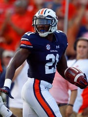 Auburn running back Kerryon Johnson (21), the Lions'