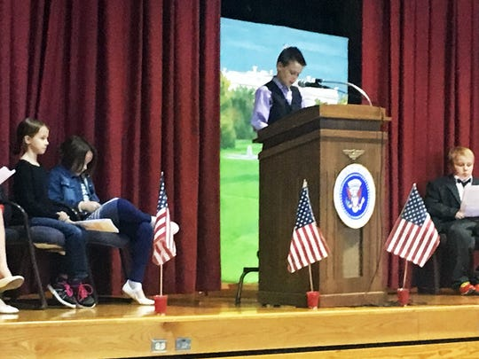 From left, fourth-grade students Annie Laubach, Jaden Clapsadl, Lily Franklin, Christian Brakke and Evan Allen participate in Southern Elementary's mock debate Friday, Nov. 4, 2016.