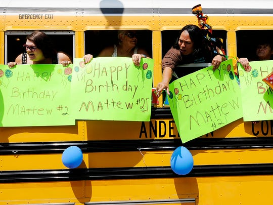 A school bus is decorated for Matthew Robinette's 21st birthday during a parade for Robinette in Anderson, Ind., on Saturday, Aug. 19, 2017. Robinette has multiple disabilities, including cerebral palsy and autism, but he loves loud noises and sirens. (Don Knight/The Herald-Bulletin via AP)