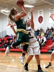 Laconia's Caitlyn Tipton makes this basket against
