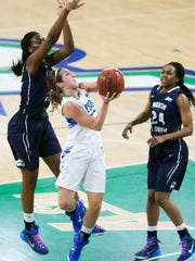 FGCU's Jenna Cobb scores against North Florida University on Friday at Alico Arena in Fort Myers.