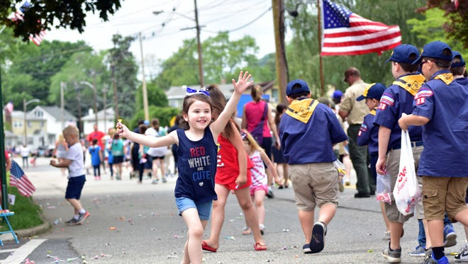 """00028635A Passaic; Pompton Lakes NJ 05/28/2017  MEMORIAL DAY PARADE: Mia Jasinski wearing a """"Red, White and Cute"""" shirt and smiling after collecting candy thrown own t othe kids.  Memorial Services will be held at 11:30 AM, at the Veterans Memorial Park, located at the corners of Lakeside Ave and Jefferson Ave. and the parade will commence following the service along Colfax Avenue.  Photo by Sandy Stucki"""