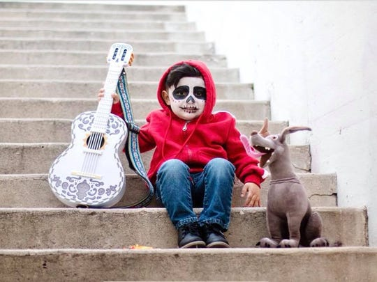 Khristopher Jarred Charles, 3, dressed as Miguel from Disney's animated film CoCo for his third birthday photos.