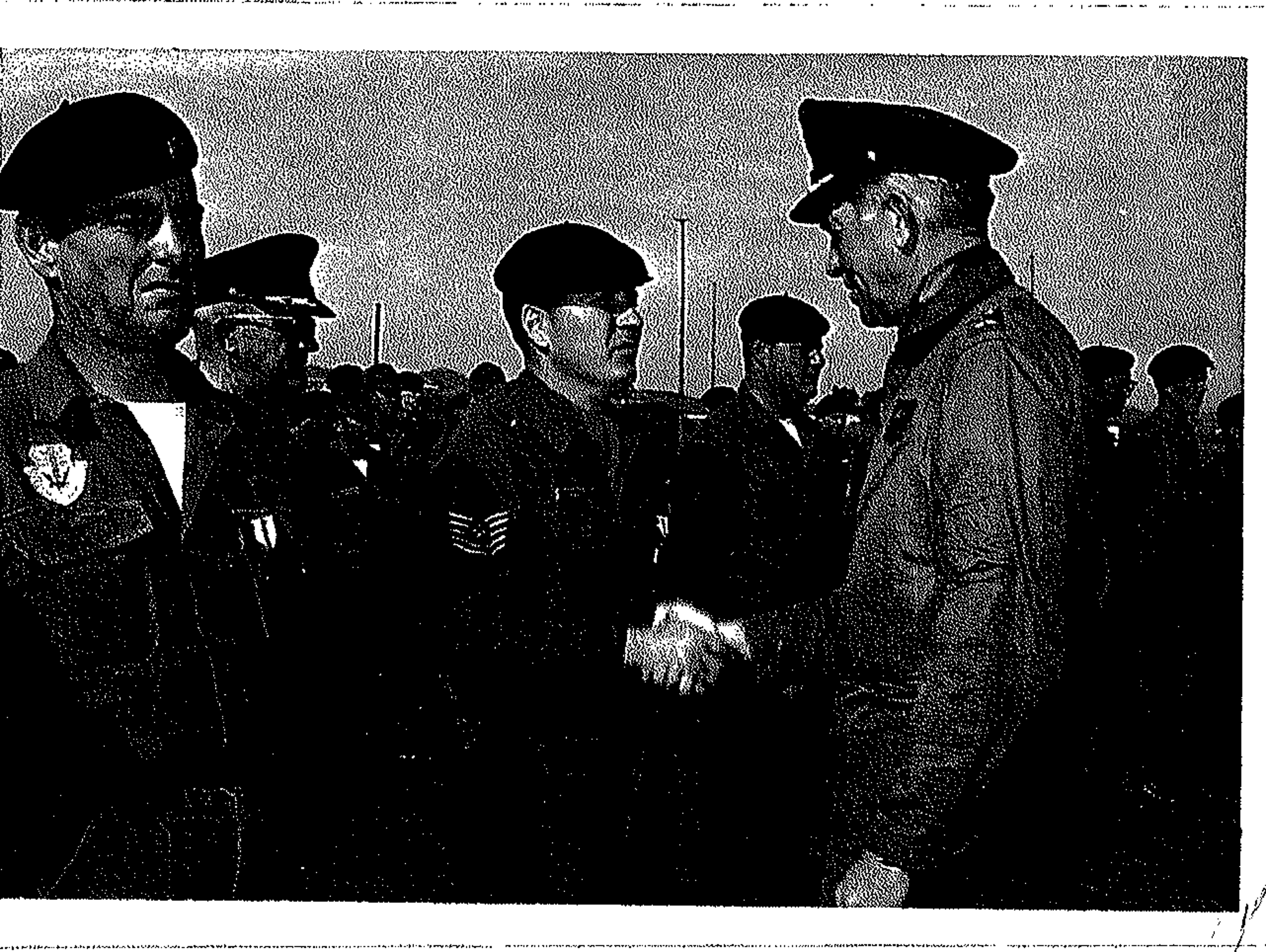 Victor Skaar, center, shakes hands with an Air Force