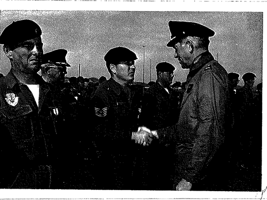 Victor Skaar, center, shakes hands with an Air Force general in February 1966 at a base in Spain.