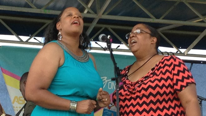Sabrina Lane (left) and Linda Faye Williams, members of the gospel group Called Out, perform at Jazz on the Grass at Alabama State University on September 1, 2014.  Called Out backed gospel singer Phil Perry, who opened the festival Monday.