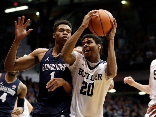 Butler guard Henry Baddley (20) looks to shoot over Georgetown forward Jamorko Pickett (1) during the first half of an NCAA college basketball game in Indianapolis, Tuesday, Feb. 13, 2018. (AP Photo/Michael Conroy)