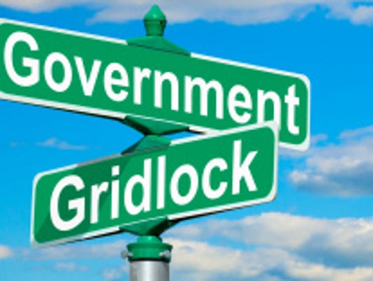 635951008504067437-stock-photo-34143096-government-gridlock-street-sign.jpg