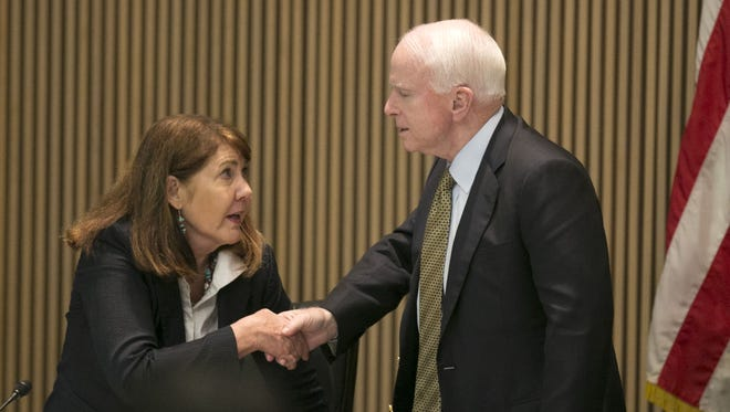U.S. Rep. Ann Kirkpatrick, D-Ariz., and  U.S. Sen. John McCain, R-Ariz., shake hands following a congressional hearing looking into the Gold King Mine Spill in Colorado from August of 2015, at Phoenix City Hall on Friday, April 22, 2016. The EPA was responsible for the spill that dumped hazardous materials into the Animas River in Colorado that impacted the Navajo and Hopi people downstream.