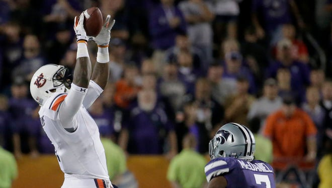 Auburn wide receiver D'haquille Williams caught a 39-yard pass from Nick Marshall to seal the Tigers' 20-14 win over Kansas State.