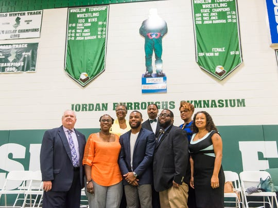 Jordan Burroughs (middle) poses for a photo following the dedication ceremony for Jordan Burroughs Gymnasium at Winslow Township High School on Saturday, September 24.