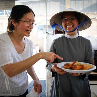 Hang Pham and Sister Anna Tran serve up traditional