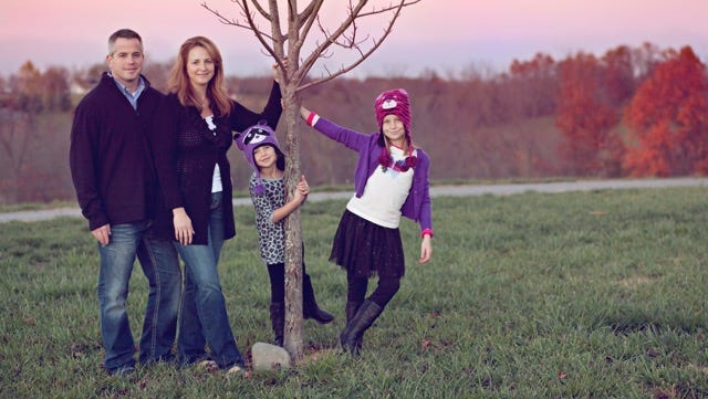 Aaron Goddard, left, was a firefighter for the Springfield Fire Department. He was diagnosed with esophageal cancer in 2013 and died June 21, 2015 at the age of 42. He is pictured here with his wife, Linda, and daughters Emery and Alex.
