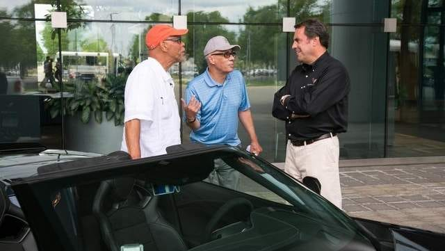 Left to right: George Talley of Detroit, Stan Jackson of Detroit and Mark Reuss, Executive Vice President for General Motors talk at the GM Tech Center in Warren on Wednesday, June 25, 2014.