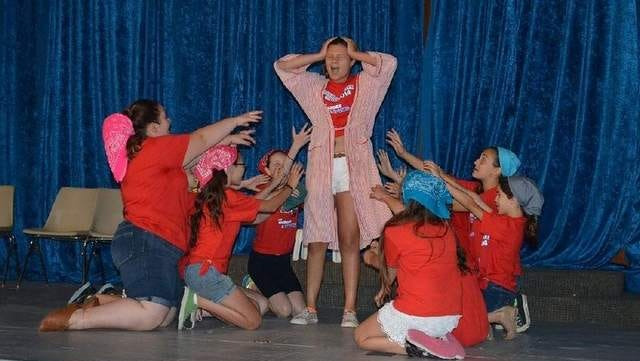 """Photo is of some of the campers during a scene from """"Annie""""."""