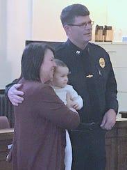 John Perrigo of the Elmira Police Department is joined