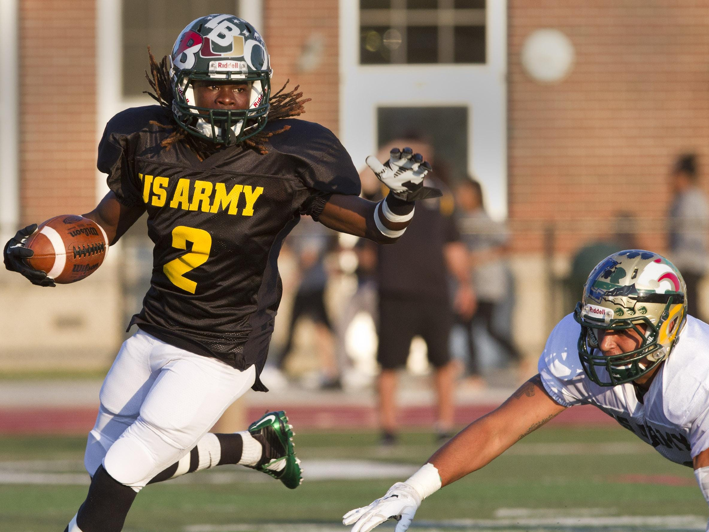 Long Branch's Dahmiere Willis gains yards in the first half of the 2015 U.S. Army All-Shore Gridiron Classic at Long Branch High School on Thursday.