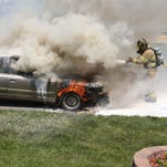 Daniel Pelton of Springfield escaped unharmed from his 2001 Mercury Grand Marquis after it burst into flames on East Evergreen Street near Glenstone Avenue.