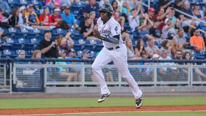 Pensacola's Gabriel Guerrero scores on a hit by Angelo Gumbs Monday night.