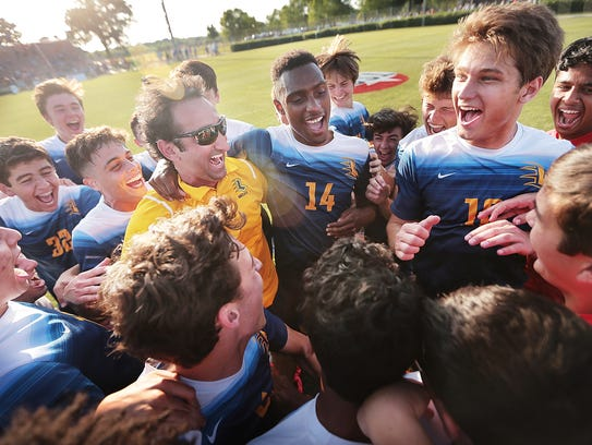 Lausanne celebrates after betaing Battle Ground Academy