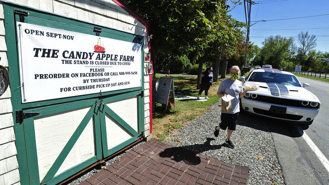 Carol Constant takes care of the customers lining up  at Candy Apple Farm in Main Street in Acushnet.
