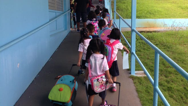 Pre-kindergarten students at Lyndon B. Johnson Elementary in Tamuning walk toward the car lane to be picked up at the end of the school day on Oct. 15, 2015. It was the Guam Department of Education's first day of its new pre-kindergarten program.