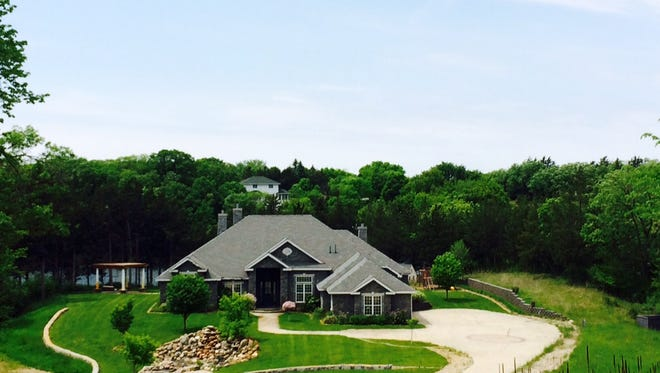 The home at 8493-187th Ave. NE, New London, maximizes outdoor experiences with features near the Crow River.