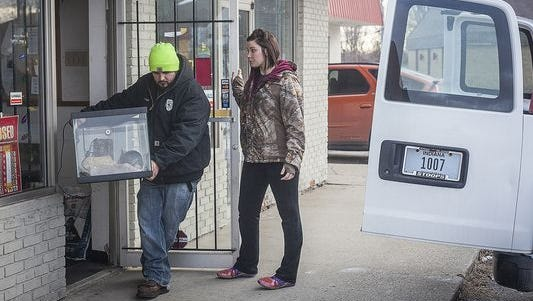 Muncie animal control officers remove more than 220 animals from a pet store on Granville Avenue.