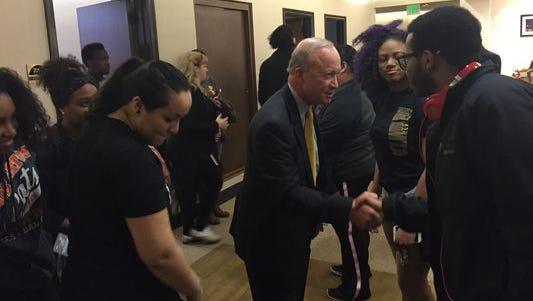 Purdue University President Mitch Daniels, center, greets students with the Purdue Social Justice Coalition in the lobby of his office in Hovde Hall on Tuesday. Daniels met with students for nearly an hour to discuss their demands about the racial climate on campus. The students held a rally on Friday that drew hundreds of students and faculty.