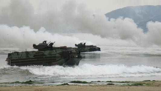 Marines aboard amphibious assault vehicles rehearse a  landing operation on Dogue beach in Pohang, South Korea, as part of an exercise in 2014.