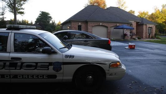 Greece police on scene of home invasion in this file photo.