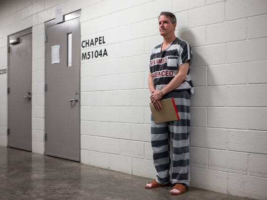 Chris Simcox waits to get taken back to his cell after