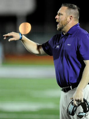 Roscoe head coach Jake Freeman yells instruction to his players during the third quarter of Roscoe's 62-0 win on Friday, Sept. 30, 2016, in Roscoe.