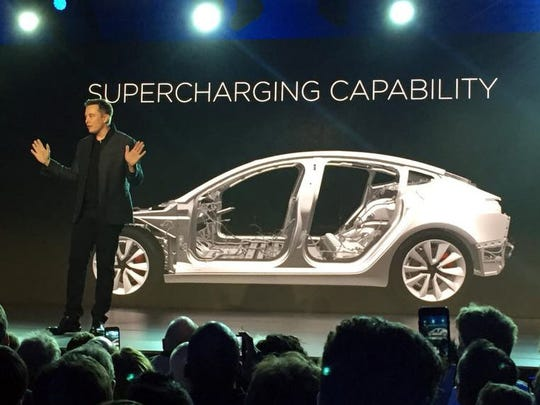 Tesla Motors Inc. CEO Elon Musk speaks at the unveiling of the Model 3 at the Tesla Motors design studio Thursday.