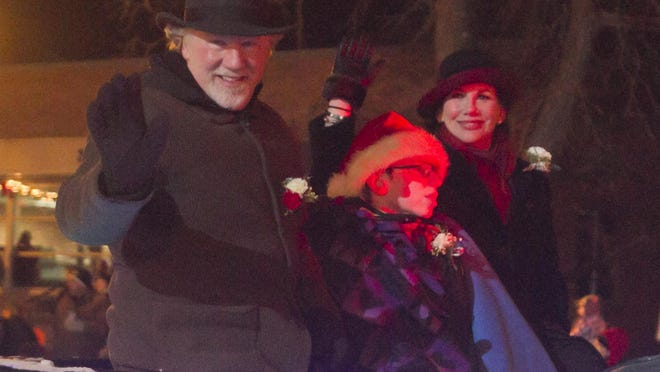 Melissa Gilbert, right, rides with husband Timothy Busfeld during last year's Fantasy of Lights parade. She has announced she is moving from Howell.