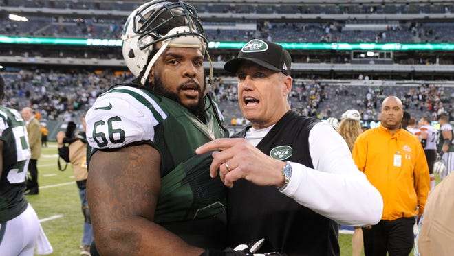 The Jets' Willie Colon, with coach Rex Ryan after a game last season , says he sees more bonding among players this year.
