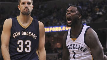 Memphis Grizzlies forward Lance Stephenson (1) dunks against New Orleans Pelicans forward Ryan Anderson (33) during the second half at FedExForum. Memphis Grizzlies defeated the New Orleans Pelicans 121-114 in overtime.