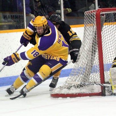 University of Wisconsin Stevens Point's Scott Henegar comes around the net to challenge UW-Superior goalie Bryce Fink Saturday in the K.B. Willett Arena in Stevens Point earlier this season.