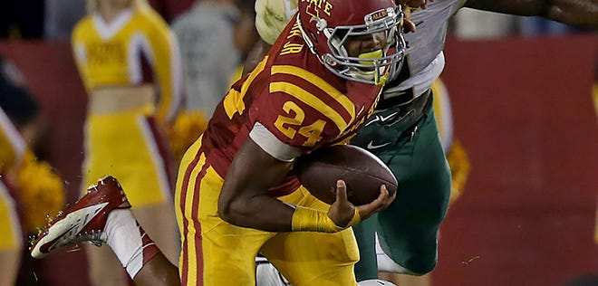 Iowa State's #24 Martinez Syria slipped away from Baylor's #20 Aiavion Edwards during game at Jack Trice Stadium in Ames on Saturday night Sept. 27, 2014.