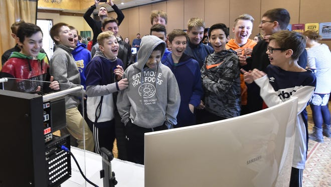 Gibraltar eighth grade students share a laugh while watching a popular video on a custom gaming computer shared by Quantum PC Services of Sturgeon Bay during Career Day on Tuesday, March 20, 2018. Tina M. Gohr/USA TODAY NETWORK-Wisconsin