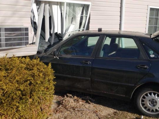 A four-door car crashed into a first-floor apartment