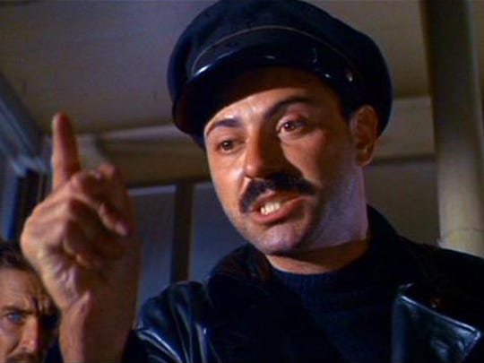 "Alan Arkin in a scene from the 1966 film ""The Russians Are Coming, the Russians Are Coming."""