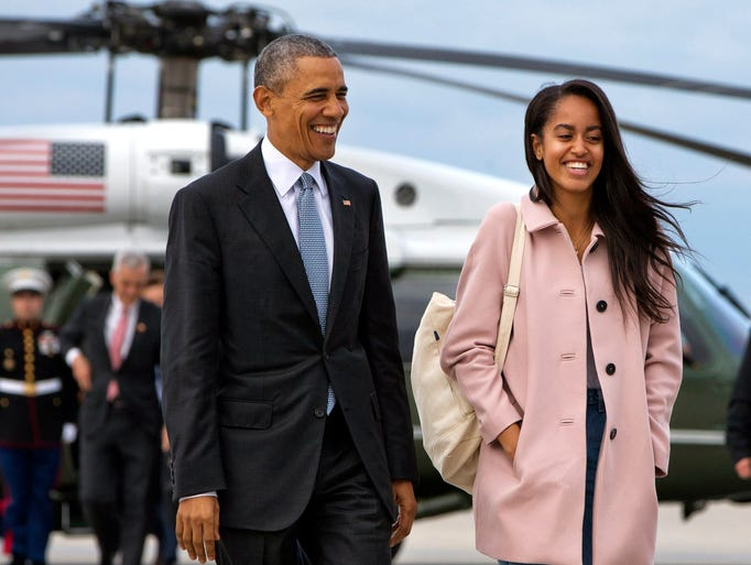 President Barack Obama jokes with Malia Obama as they