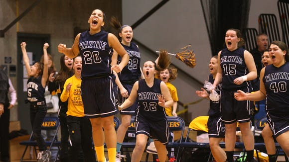 Wayne's Shyana McLeod (20) celebrates after sinking the game-winning shot with 0.7 seconds on the clock last year against Geneva. Wayne won the Section V Class A2 championship with the 61-59 victory.