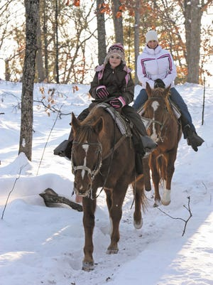 Go for a winter horseback ride at Woodside Ranch in Mauston.