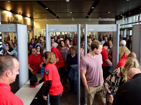Garth Brooks fans go through metal detectors before